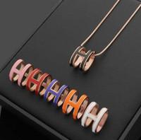 cadena de letras h al por mayor-Bajo al por mayor H cilindro collar de goteo en blanco y negro rojo naranja polvo drip hueco H carta collar collar de cadena de hueso de serpiente