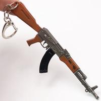brinquedo modelo de rifle venda por atacado-12 cm PUBG 7.62mm Rifle AKM Modelo Chaveiros Brinquedos Arma chaveiros llaveros chaveiro sleutelhanger Anel Chave Chaveiro