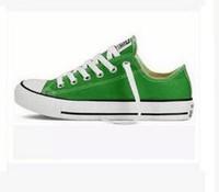 calzado de lona superior al por mayor-Zapatos de lona de la parte superior baja de las mujeres clásico de los hombres Zapatos de lona del amante con cordones calzado Zapatillas de deporte unisex zapatos de negocios ocasionales