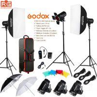 regenschirm licht gesetzt großhandel-Godox E300 14in1 Professionelle Studio Blitz Fotografie Licht Set + Koffer + Tragbare Regenschirm Softbox Licht Stand Trigger