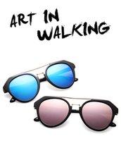 gafas de animales al por mayor-Gafas de sol de moda de alta calidad para hombre mujer Erika Eyewear Designer Brand Gafas de sol Lente de espejo Gafas redondas Caja y estuches