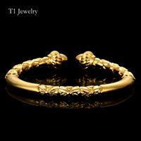 pulsera dubai al por mayor-Cabeza de flor al por mayor brazalete brazalete pulsera de cobre color oro Dubai Dragon patrón pulsera mujeres