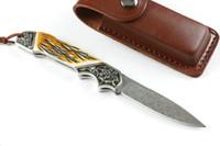cuchillo de bolsillo de cuerno al por mayor-Oferta especial Cuchillo plegable Hoja de acero de Damasco Cuerno + Mango de cobre Bloqueo Espalda Cubiertas plegables de bolsillo Cuchillas de cuero EDC
