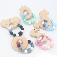 kinder perlenformen großhandel-Baby Kinderkrankheiten Armband Spielzeug Kleintierförmige Schmuck Beißring Für Baby Bio Buchenholz Silikon Perlen Baby Rassel Kinderwagen Kinder Spielzeug