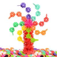 ingrosso blocca giocattoli educativi di plastica-300pcs bambini bambino giocattoli per bambini blocchi di costruzione multicolor fiocco di neve creativo educativo costruzione di giocattoli di plastica consegna casuale