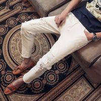 Wholesale joker trousers - New 2018 Fashion men hip hop student white black Casual trousers Joker pants male ripped hole jeans beggar jeans 28-34