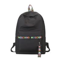 lona mochila venda por atacado-Mos designer mochila para mulheres meninas grande capacidade mochilas de lona com preto branco rosa 3 cores de alta qualidade mochila de transporte da gota