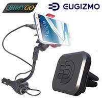 soporte para coche iphone usb al por mayor-Soporte para teléfono del coche Soporte USB dual Cargador de cigarro Montaje + Vehículo Soporte de ventilación de aire magnético Cunas para iPhone Samsung Lenovo Huawei LG