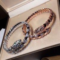 brazaletes de oro blanco para las mujeres al por mayor-Nuevo 3A piedra de circón cúbico medio pavimentada bijoux femme animal serpiente pulseras brazaletes blanco / rosa / oro-color de joyería para las mujeres