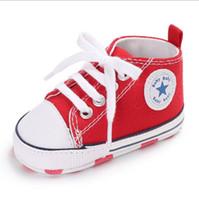 andador para bebé durante años al por mayor-zapatos para niños nuevos 0-1 años de edad, hombres y mujeres zapatos de Walker con fondo blando estrellas lienzo zapatos para bebés