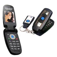 teclas giratorias para coches al por mayor-Flip Mini Teléfono celular de dibujos animados Llave del coche Teléfono celular Desbloquear tarjeta GSM única Modelo de coche pequeño Cámara FM Teléfono celular X6
