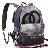 964ea9019c3b1 2018 Yeni SıCAK 35 CM ve 40 cm Graffiti Baskılı Tuval Sırt Çantası halat  çanta renkli baskı tuval sırt çantası okul çantası ile işlemeli