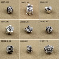 ingrosso perline europee di distanziometro metallico-I branelli misti misura i braccialetti europei incanta il metallo d'argento antico la lega di zinco incanta i distanziatori dei branelli che fanno i monili che fanno 100pcs / lot