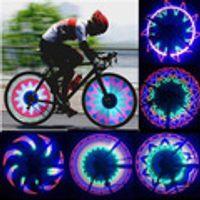 ruedas fijas al por mayor-! 2 Side LED 32 32 Modo nocturno impermeable de la señal de la rueda de la lámpara reflectante borde del arco iris de Neumáticos Bicicletas bici habló la luz fija Advertir