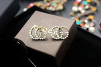 silicone de platine de qualité achat en gros de-Prix usine de haute qualité luxe lettre perle diamant boucles d'oreilles mode abeille métal boucles d'oreilles avec boîte