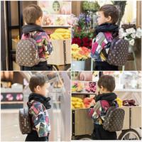 patrones de mochila para niños al por mayor-Moda para niños Mochila Los más nuevos niños Mochilas escolares Patrón clásico PU Diseñador Niños Hombros Bolsas Bebé Viajes Snacks Bolsas Regalos de Navidad