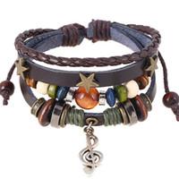 boutons d'étoiles en bois achat en gros de-Fait à la main Boho Gypsy Hippie Design En Cuir Marron Avec Star Note Charmes En Métal En Bois Bouton Perles Wrap Unisexe Réglable Bracelet