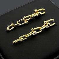 colgante de polvo de oro al por mayor-Nuevos pendientes de acero inoxidable en forma de U de alta calidad Pendientes largos de oro rosa de 18 quilates vienen con bolsa de polvo para regalo de pareja