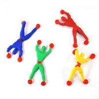 aranhas de borracha macia venda por atacado-Novo peculiar divertido criativo de borracha macia parede de escalada pessoas Superman brinquedos das crianças automaticamente virar com um homem-aranha pequeno presente