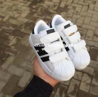 sapatos femininos 25 venda por atacado-Promocional Venda Quente 2018 clássico calçados casuais das crianças nova primavera meninos sapatos meninas calçados esportivos tamanho 25-35 17.5 cm-22.5 cm