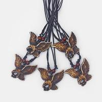 ingrosso gioielli intagliati-DropShipping 12pcs Faux Brown Yak Bone intagliato Eagle Charms collana pendente gioielli in resina animale