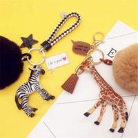 llaves de jirafa al por mayor-Amantes de los llaveros, Corea del Sur, linda cebra, bolsa de jirafa, cadena de llaves del auto, bola de pelo de conejo, bola de flor eterna de bricolaje.