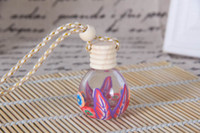Wholesale wholesale perfume bottle charms - Most Popular 200pcs lot Hangings Glass Perfume Bottles Polymer Clay Vials for Essential Oil Fragrance Bottle Charming Car Pendant Decoration
