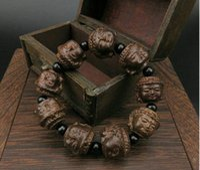 armband tibet buddhismus großhandel-Sandelholz Carving Buddha Kopf Perlen Tibet Buddhismus Amulett Armband