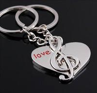 ingrosso portachiavi musicali-1pcs = cuore + musica Lovely Metal Music Symbol argento placcato nota musicale portachiavi per le donne Anello chiave gingillo per accessori auto