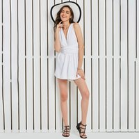 268f02a114d6 New Summer Women White Jumpsuits Rompers Hollow Halter Sleeveless Causal  Mini Short Backless Pleated Deep V Neck Bench Jumpsuits Rompers