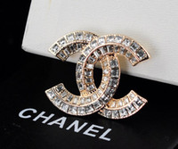 Wholesale brass rhinestone brooch online - 2019 design Celebrity Letter Pearl Heart shaped Brooch decorations Fashion Metal Letter diamond brooch Jewelry With Box