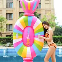 tubo de agua para niños al por mayor-Caramelo inflable que vacia el juguete del agua Playa del verano Diversión Fila flotante monta para los niños Piscina para adultos Tubos de aire Swim Ring 70xy Y