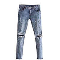 cortes de jeans venda por atacado-New Hot Moda Buraco Jeans Rasgado Das Mulheres Na Altura Do Joelho Corte Skinny Fit Elástico Senhoras Denim Pérola