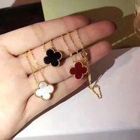 halsketten muscheln großhandel-Modeschmuck Vierblatt Blume Halskette Schwarz und Weiß Rot Grün Vierblatt Blume Muschel Achat 925 Silber Halskette Diamantschnalle