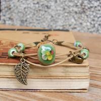 ingrosso pietra verde cinese-Braccialetti di ceramica lunghi fatti a mano pietre di stoffa fioritura verde corda intrecciata Stile cinese vintage lascia perline di ceramica gioielli regalo di moda