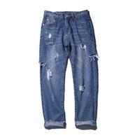 süngerimsi kot pantolon toptan satış-2018 İlkbahar yaz yeni moda kot ripped mavi erkek han baskı harlan eğilim ince pantolon yakışıklı baggy Ücretsiz kargo