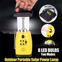 bombilla linterna de mano al por mayor-Más reciente de energía solar manivela Dynamo emergencia 8 LED bombillas 2 modos exterior linterna de camping FM Radio linterna AAA antorcha
