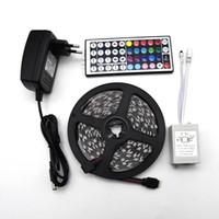 rollo de alambre led al por mayor-Cinta LED RGB a prueba de agua 5M 5050 SMD Cinta de luz LED cinta flexible con control remoto IR y adaptador de corriente DC 12V conjunto completo
