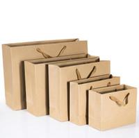sacos de compras segurados do papel marrom venda por atacado-Fácil levar o saco de papel de Kraft com o saco de papel de Brown do logotipo da impressão feita sob encomenda dos sacos de compras do papel do ofício de E-co