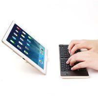android tv box blue achat en gros de-F66 Clavier Bluetooth pliable portatif avec pavé tactile, deux boutons universels pour tablettes 10 pouces argent / or au choix