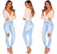 jeans de mujer destruidos al por mayor-Venta caliente Ripped Jeans Denim Joggers Agujeros de rodilla Slim Fit Jeans Para mujeres Blue Rock Star Jumpsuit para mujer Jeans destruidos Boyfriend Lápiz