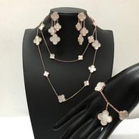 conjuntos de pulseiras de colar de pérolas venda por atacado-Marca de moda 925 prata quatro folhas flor conjunto de jóias para as mulheres colar de casamento pulseira brincos branco mãe pérola shell trevo jóias