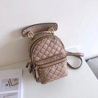 Wholesale black leather backpack for men - New Top quality Fashion genuine leather luxury designer black Mini rivet backpack women handbag for party