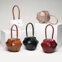 sacs à main brillants achat en gros de-2018 mode européenne et américaine sac à main en cuir de dame vintage sac jingling boulette sac Yunyunnu