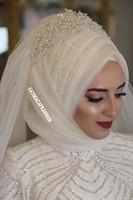 vestido de novia blanco tren rojo velo al por mayor-Velos de novia musulmanes de marfil 2018 Perlas de cuentas Hijab de boda de tul para Arabia Saudita Novias Velos de novia hechos a medida hasta el codo