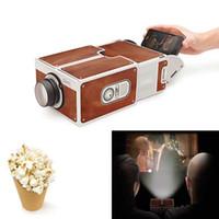 projeções de video venda por atacado-2018 Novo Mini Cinema Portátil DIY Cartão de Projeção Smartphone Projetor de telefone Móvel para Casa Projetor de Áudio e Vídeo presente