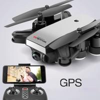 camara para control remoto de helicoptero al por mayor-Mini S9 Folden GPS Drone 2.4G 4 ejes control remoto RC helicóptero Drone con 2MP / 5MP Wifi HD cámara Drones aviones GPS