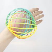 ingrosso braccio in plastica-Arcobaleno 3D Anello di flusso del braccio Giocattoli di plastica Toroflux Anello magico giocattoli di decompressione Bambini Regali per bambini 60pcs OOA4745