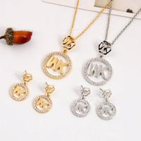 ingrosso gioielli europee grandi-2018 Europa e Stati Uniti big gold M lettera esagonale collana di diamanti orecchini pendenti gioielli due pezzi insieme dei monili