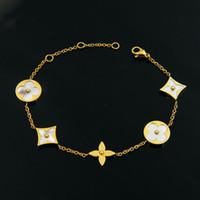 vente de breloques en or rose achat en gros de-chaîne de marque de vente chaude de bracelets de charme de trèfle en acier inoxydable avec Shell et fleur pour les bijoux de mode de femmes bracelets d'or rose
